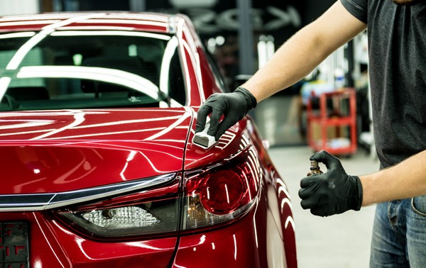 man applying high end car waxing
