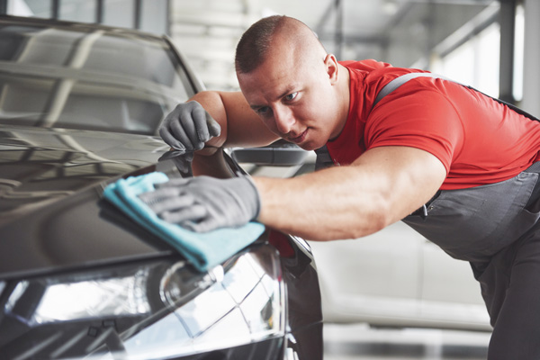 car detailer performing paint services