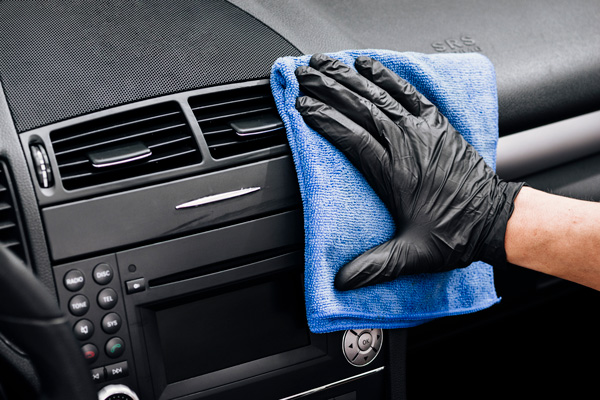 cleaning car dashboard interior detailing