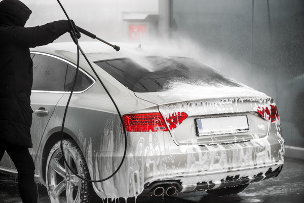 washing car exterior using high pressure water pipe